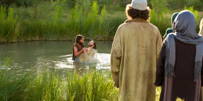 Jesus Baptized in Jordan symbolism going down